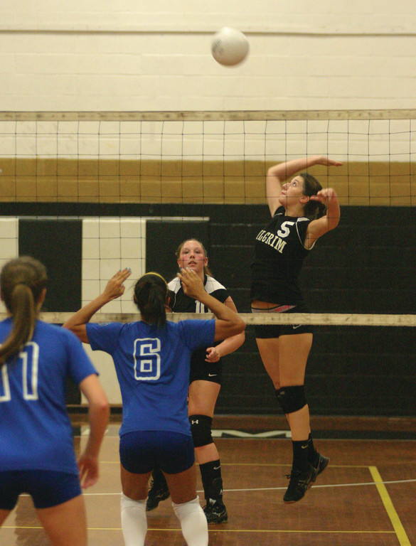 GOING UP: Colleen Conti reaches for a hit during a match last season for Pilgrim. Conti and Megan St. Jacques are serving as captains this year.