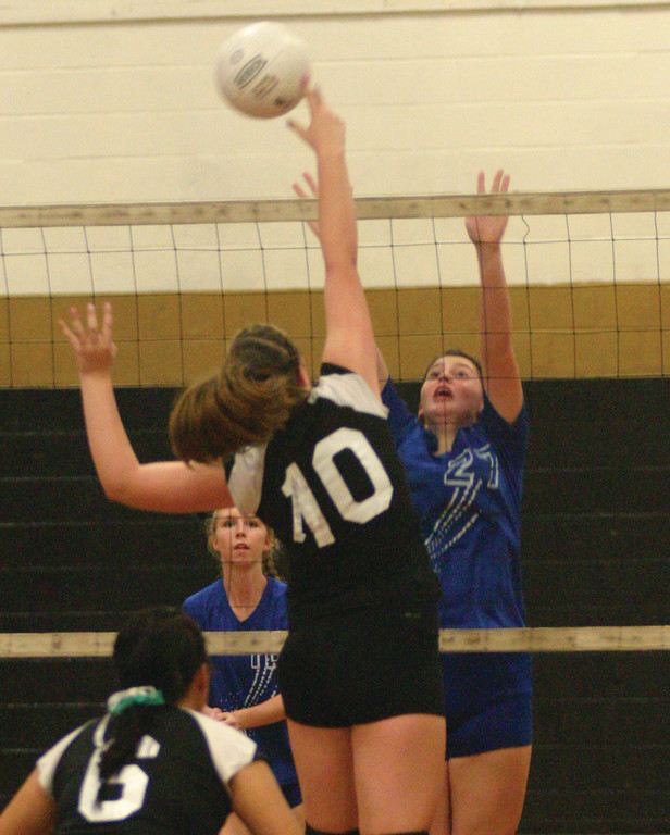 RIVALRY MEETING: Vets� Jess Tyree and Pilgrim�s Megan St. Jacques battle at the net during a game last year. Vets, Pilgrim and Toll Gate will all be in the dame division this year.