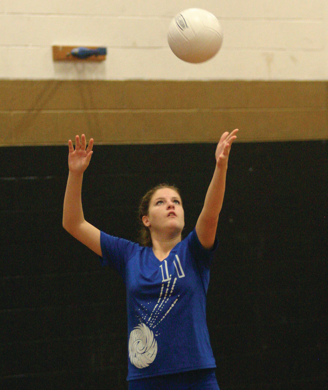SERVICE: Samantha Beaufort sets up a serve during a match last season for Warwick Vets.