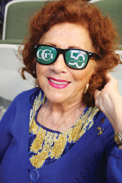 REMEMBERING THE PAST, CELEBRATING THE FUTURE: Fiftieth-anniversary glasses were among the items given those who attended the CCRI opening day convocation Thursday at the Knight Campus. Edna O'Neill Mattson, who has been on the college staff for more than 37 years, put them on instantly.