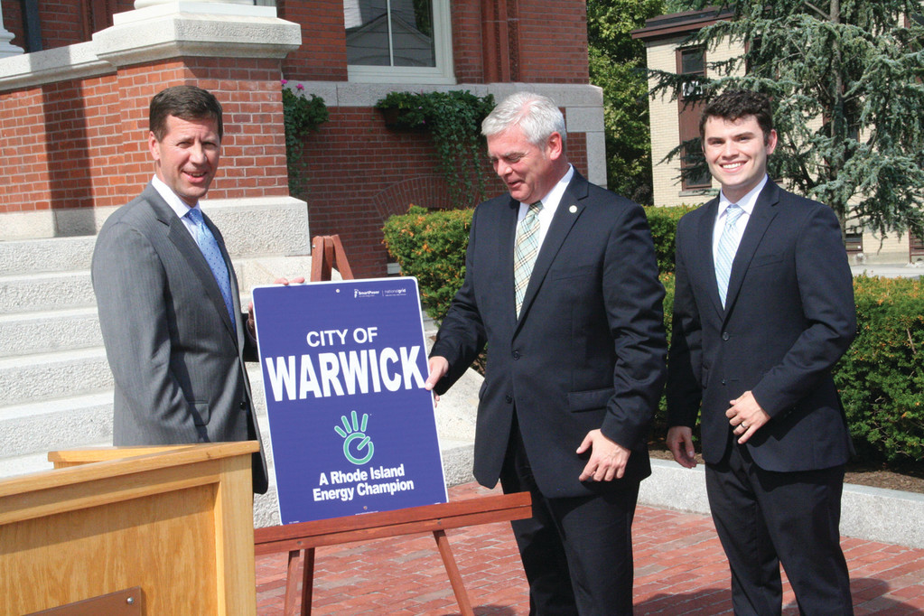 WARWICK IS AN ENERGY CHAMPION:  National Grid Rhode Island President Timothy Horan and Mayor Scott Avedisian at Tuesday's announcement in front of City Hall.