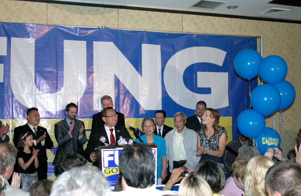 GOP WINNER: Mayor Allan Fung – surrounded by staff, family members and friends – addresses supporters at Warwick's Crowne Plaza Hotel on Tuesday after being named the winner of the Republican gubernatorial primary.