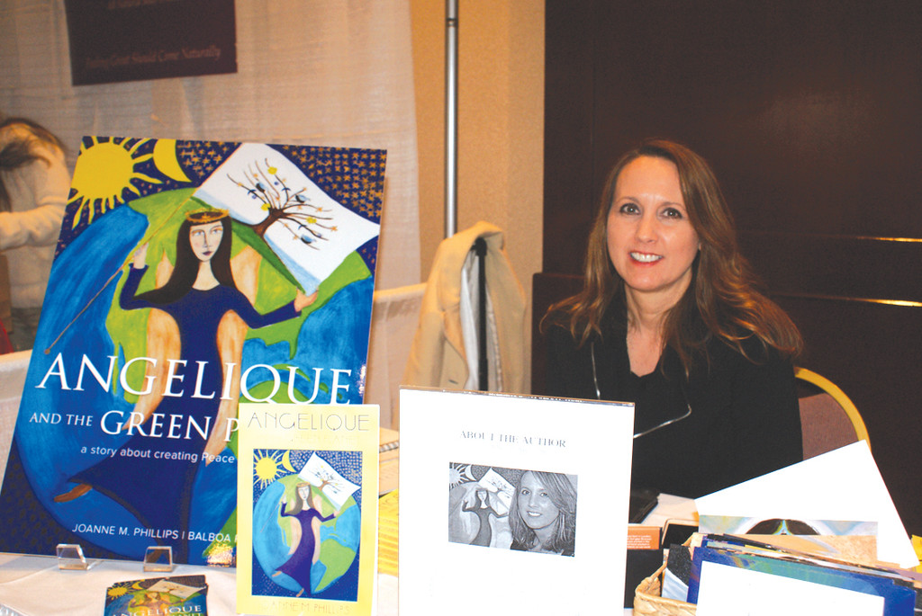 "LOCAL AUTHOR: Selling her book ""Angelique and the Green Planet,"" a story about creating peace on Earth, is author Joanne M. Phillps, a graduate of Cranston High School East."