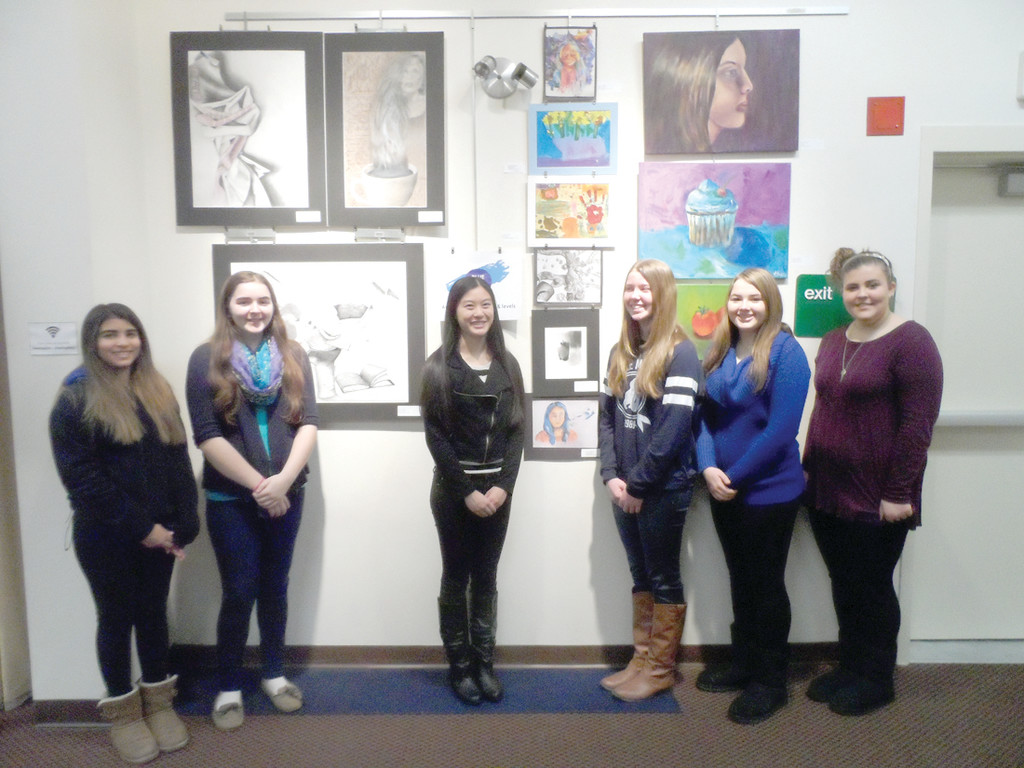 CREATIVE DISPLAY: Blue Door Studio students Liliana Zapata, Laura Wilson, Eileen Phou, Sarah Bannon, Erin Turnbull, Hannah Williams gather near their works currently on display at the Cranston Public Library's Central Branch. Not pictured are Isabella Corso and Alexa Gardner.