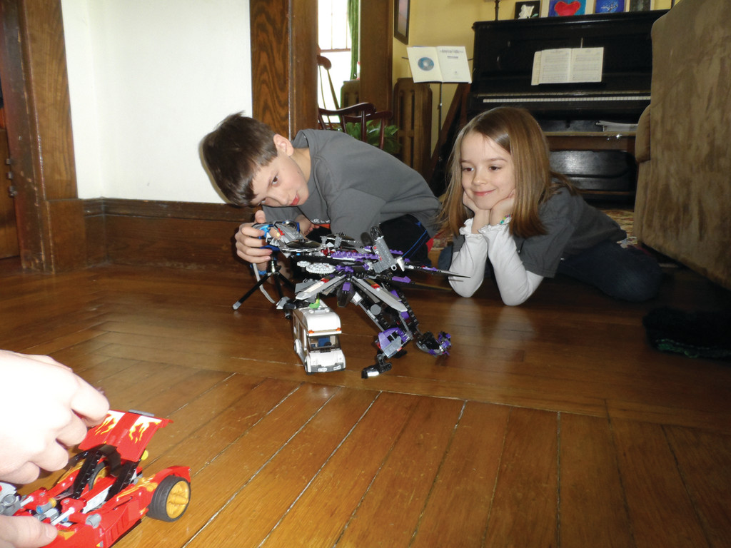 Elliot and Helena Fisher play with their Lego creations.