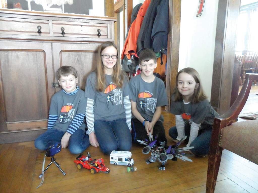 SILVER SCREEN SIBLINGS: From left, Harrison, Eden, Elliot and Helena Fisher gather with some of the Lego creations used in making their short films.