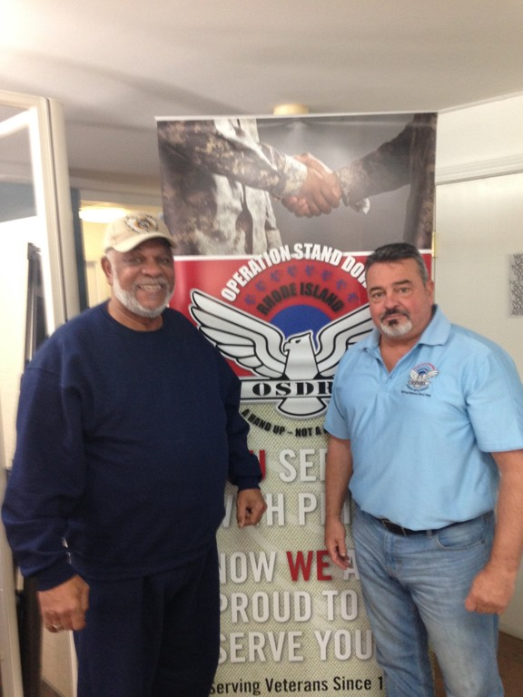 HAPPY TO HELP: Vietnam Veteran Donald Washington (left), who lost his home and belongings in Wednesday's fire, stands with Operation Stand Down's Director of Supportive Services John McDonough, who is assisting Mr. Washington rebuild his life.