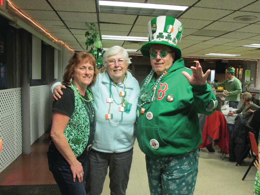 Lori Eaton, who serves as party planner and treasurer for the Tri-City, is joined by Frank and Janet Murphy at the St. Patrick's Party at Lodge 14 on West Shore Road in Warwick.