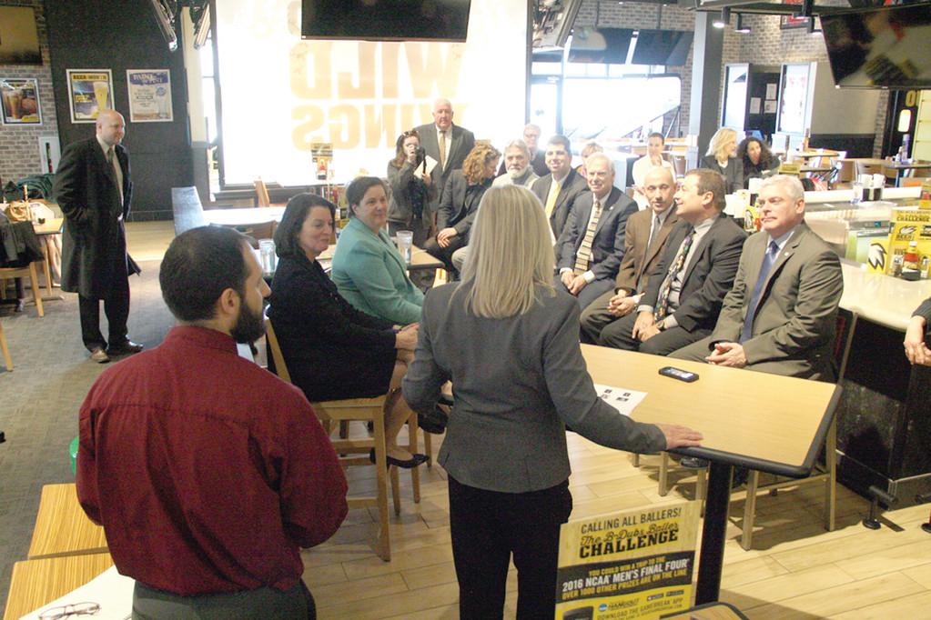 AT THE BAR: Mayor Scott Avedisian joined legislators at the bar at Buffalo Wild Wings last Tuesday to learn how the restaurant has worked with the Trudeau Center  to hire employees.
