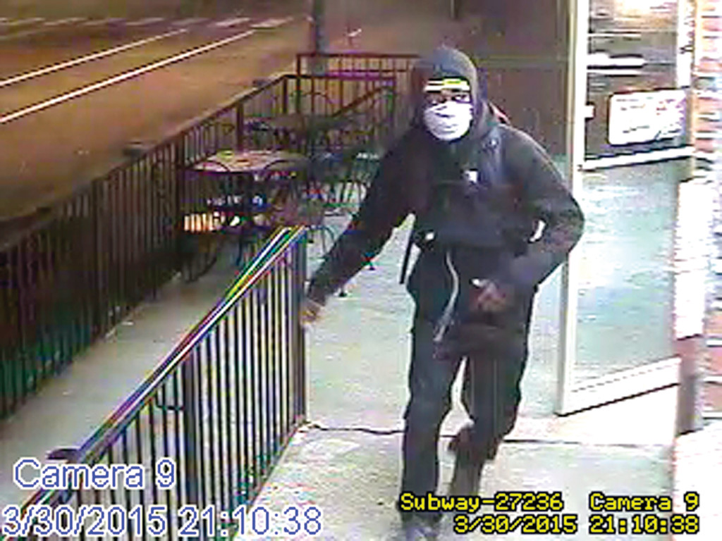 ARMED ROBBERY: This image taken from surveillance footage shows the suspect in Monday's armed robbery at the Subway restaurant on Narragansett Boulevard.