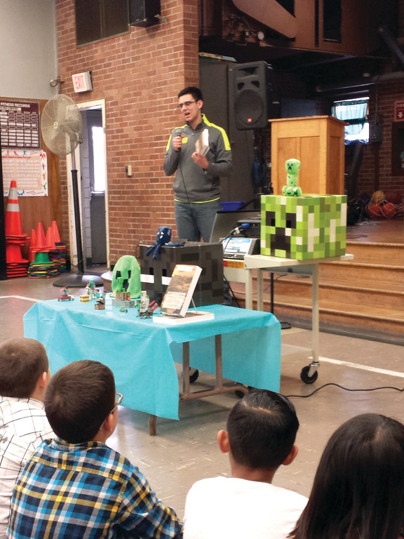 YOUNG AUTHOR: Sean Fay Wolfe, a 17-year-old author of a book set in the world of Minecraft, was able to relate to the students' love for the game when he spoke at Eden Park last week.