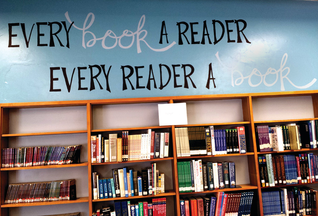 "MORE THAN A MURAL: The statement found on the walls of the Park View Middle School library – ""Every book a reader, every reader a book"" – represents Stephanie Mills' mission."