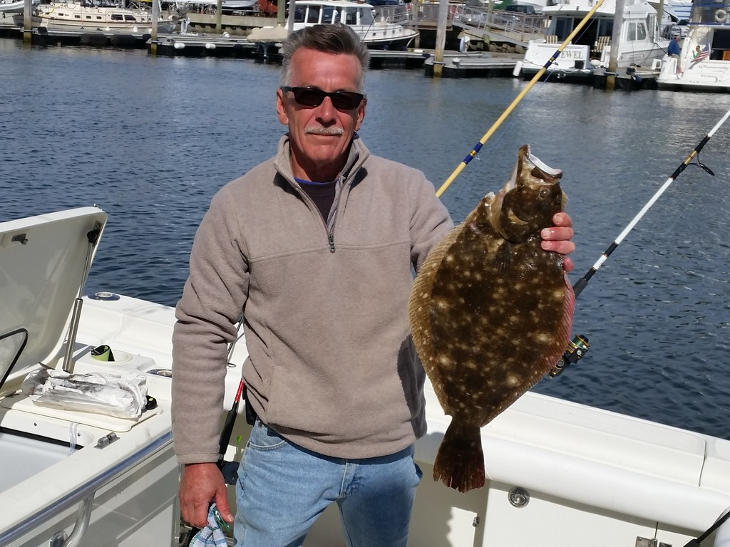 "Frank Travis of North Kingstown with the 24"" fluke he caught west of New Harbor, Block Island this week."