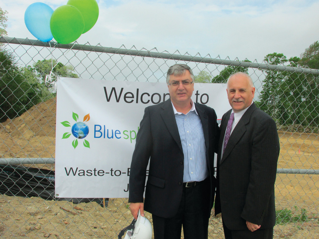 WELCOME TO TOWN: Shlomi Palas, CEO of Blue Sphere, and Mayor Joseph Polisena stand at the entrance to where the international company will build a nearly $19 million facility.
