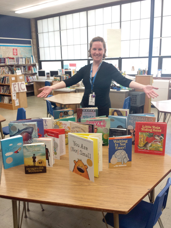ALL THIS AND 'MOORE': Meredith Moore, one of Cranston's elementary librarians, has applied for and received nine grants in three years, and has increased her library resources by more than 700 books in each of her libraries this year alone. The books shown here are just a few of the most recent additions to her library at Stadium School.
