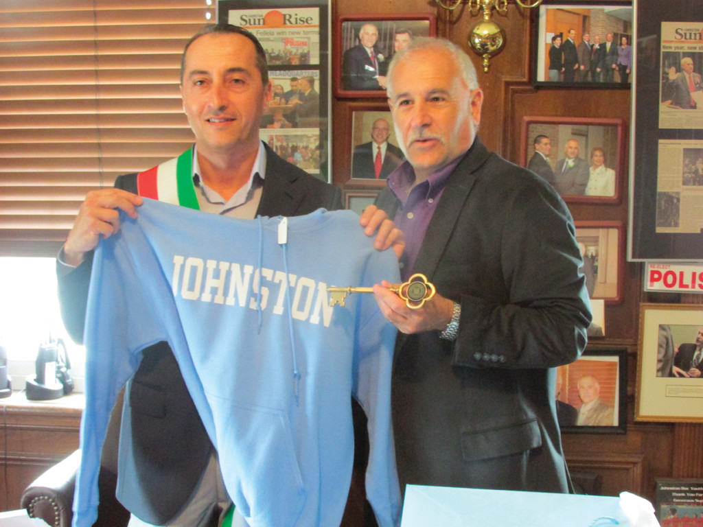 KEY TO THE TOWN: Ciruolo receives a Johnston High School shirt and a key to the town from Polisena at Town Hall.