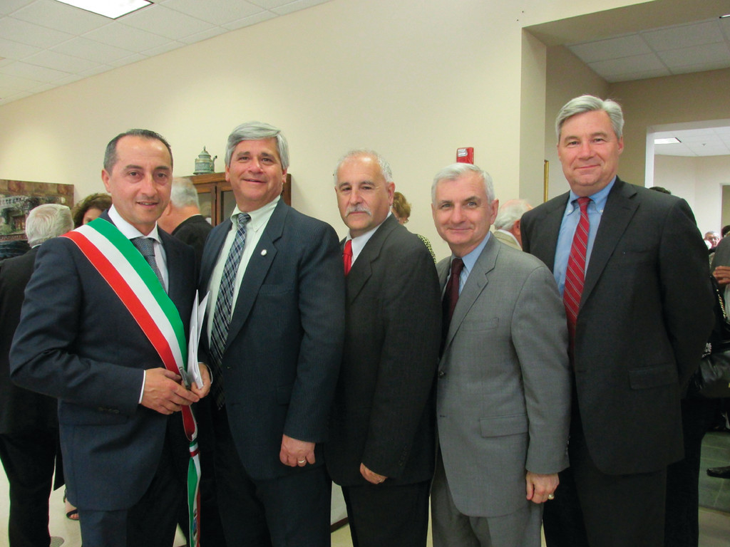 LEADERSHIP TEAM: From left, Ciruolo, Attorney General Peter Kilmartin, Mayor Joseph Polisena, and U.S. Sens. Jack Reed and Sheldon Whitehouse share a moment at the senior center.