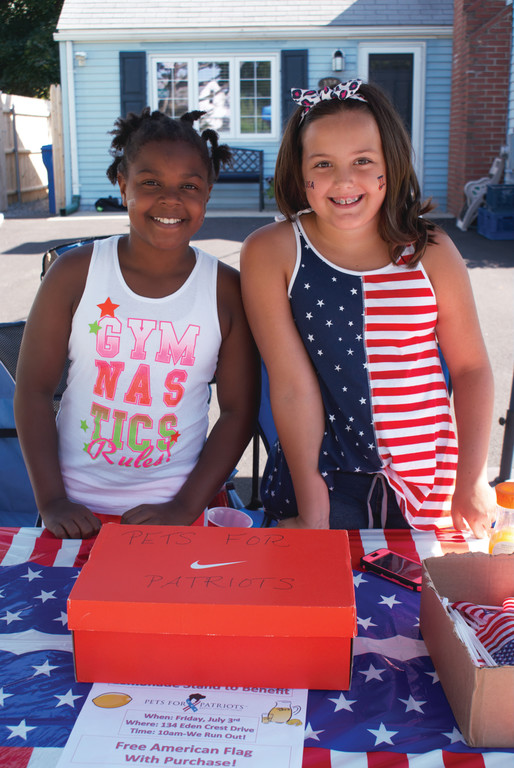 FRIENDS WITH A CAUSE: Oliva VanPatten, 9, and her friend Amani Jackson, 10, ran a successful lemonade stand to benefit Pets for Patriots.