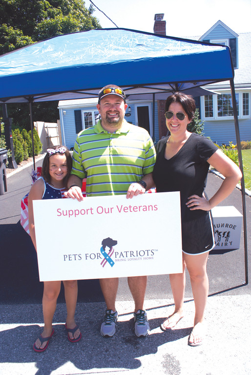 FAMILY MATTERS: It was through parental support that Oliva VanPatten held a successful Lemonade Stand on July 3. Pictured with Oliva are her dad, Bryn, and her mom, Liz.