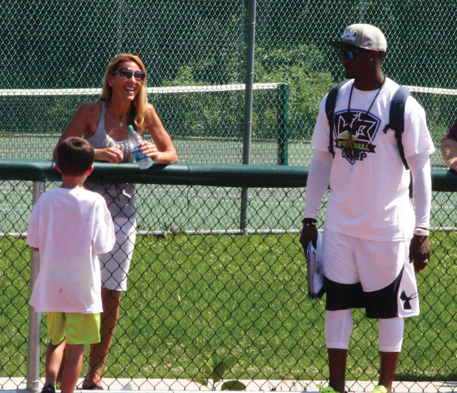 NFL TALENT: Will Blackmon of the Washington Redskins interacts with a youth football player and his mother at Blackmon's first football clinic back in 2015.