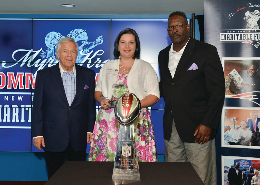 PROJECT SWEET PEAS: Pictured from left to right are Robert Kraft, owner of the New England Patriots, Corin Nava and Pro Football Hall of Famer Andre Tippett at the award ceremony June 9th. Volunteers from across New England were celebrated at an award ceremony at Gillette Stadium on June 9th. Nava won a grant for $5,000 to go towards her non-profit Project Sweet Peas, which helps and supports families in the NICU.