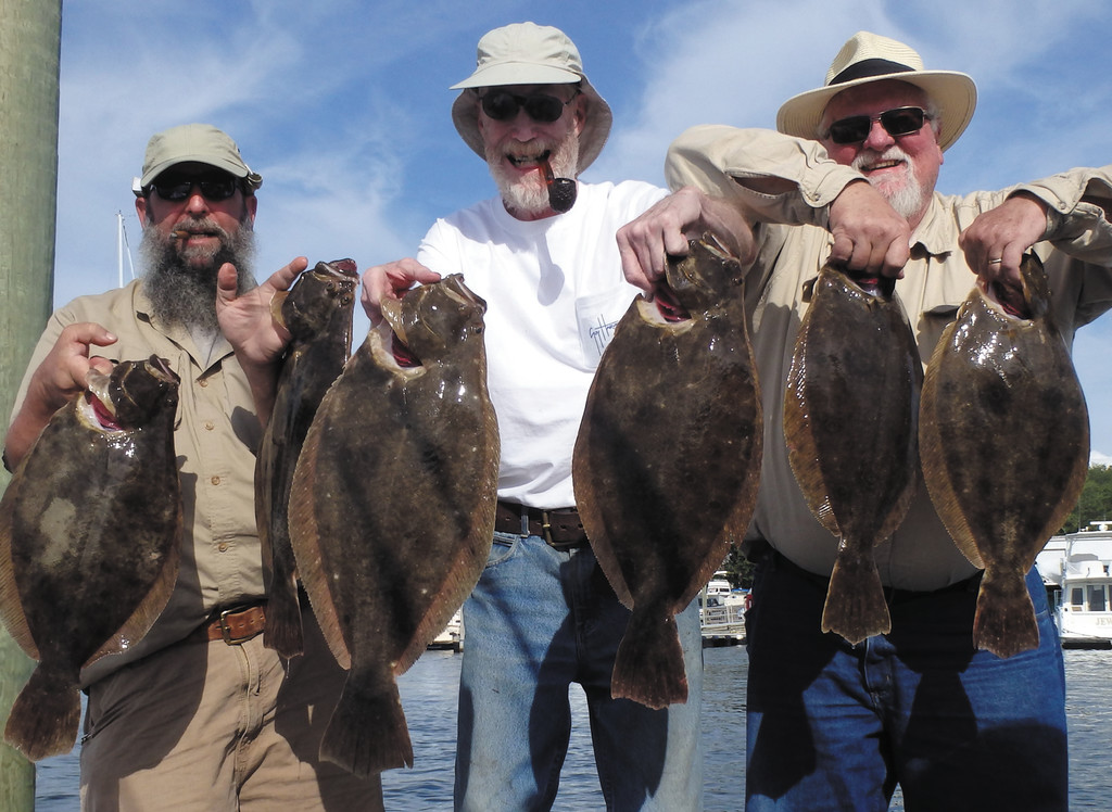 Larry Mouradjian (DEM associate director), Sandy Kane (charter captain) and Larry Radke (scientist/consultant) enjoy a day of summer flounder (fluke) fishing off Newport.  The trio netted 15 nice fish to 25 feet.