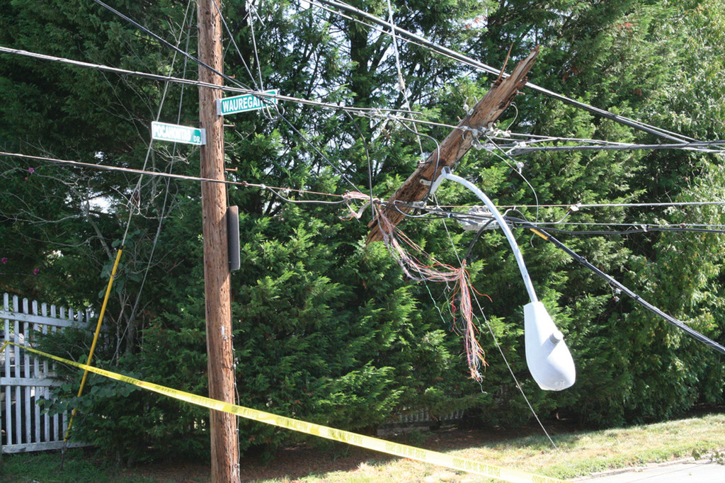 ROOT OF THE PROBLEM: Downed wires and transformers like these at the intersection of Pocahontas and Wauregan Drives couldn't be restored until downed trees and limbs were removed.