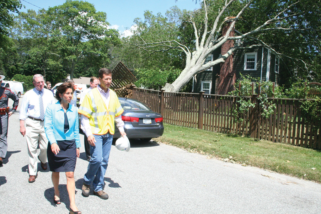 DISASTER TOUR: Governor Gina Raimondo, accompanied by National Grid Rhode Island president Timothy Horan and local officials including Rep. Joseph McNamara, viewed Governor Francis Farms damage yesterday afternoon.