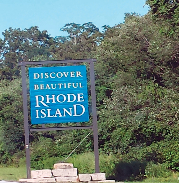 NEVER LOOKED SO GOOD: Our kids couldn't even recall what the Rhode Island welcoming sign looked like before this trip. Now, I don't think they'll ever forget it. By the time we reached the R.I. border, we couldn't wait to be home.