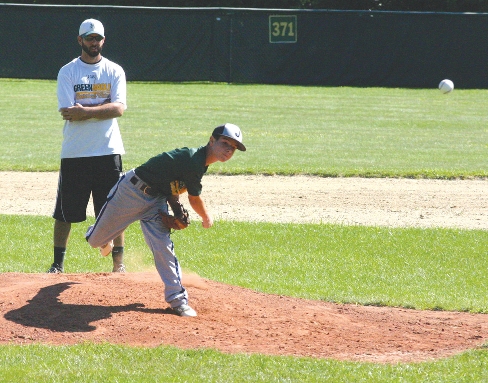 Chris Sheehan serves as an umpire during a scrimmage on Friday as a player fires a pitch to the plate.