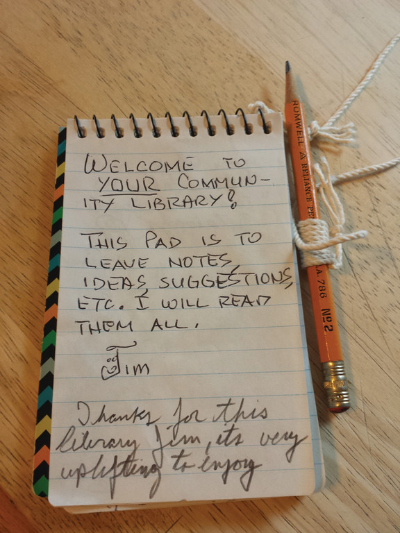 PLEASE LEAVE A MESSAGE: Jim Rigg placed a little notebook into the library on the very first day it was open, and asked people to leave a message when they visit.