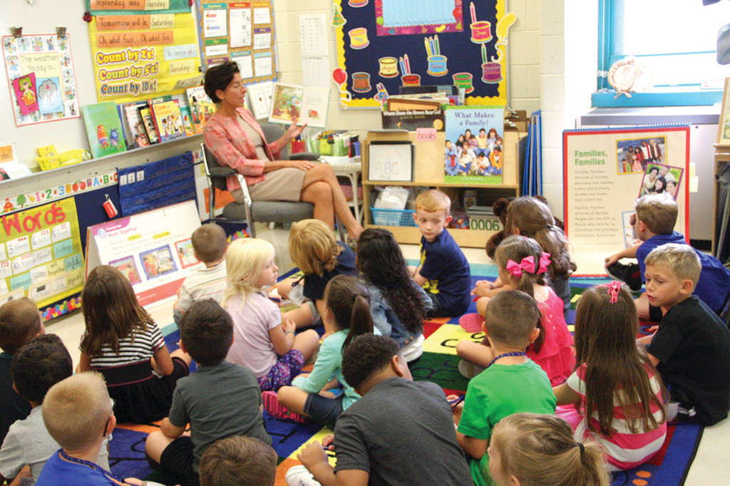 IN COMMAND: Gov. Gina Raimondo reads to kindergartners in the Hoxsie class of Jane Conley Friday during her visit to the school.