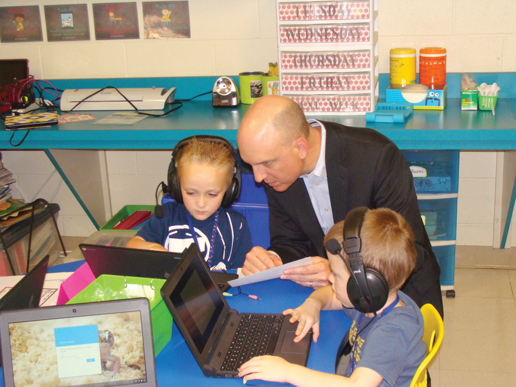 COMMISSIONER OF EDUCATION: Ken Wagner watches one student perform on a Chromebook. He said that blended learning allows students to participate in lessons on their own individual level. Those students who need a little more time to grasp concepts are allowed that time and students who excel have the availability to move forward.