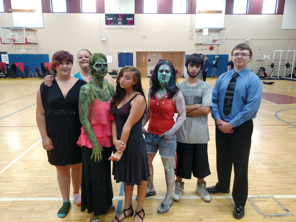 "PROM: The Don Rodrigues Karate Academy provided 18 extras altogether for ""Sam and Mattie's Teen Zombie Movie."" They played zombies, dancers, gym rats, and even prom-goers. Here some of the students are pictured dressed for their big night."