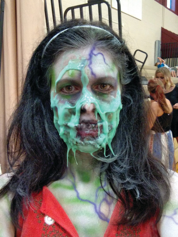 THRILLER: Christine Rodrigues, pictured in makeup, said it took about and hour to transform her into a camera-ready zombie for filming.