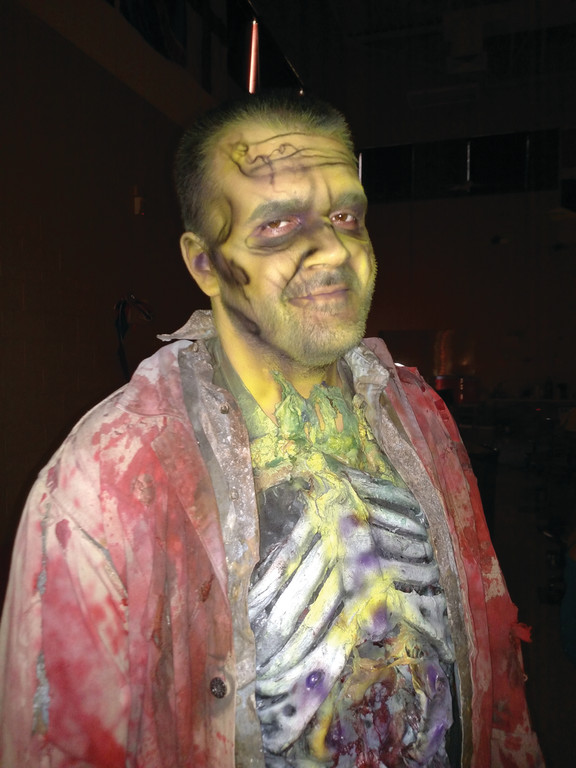 MULTIPLE ROLES: Christopher Rodrigues, pictured in full makeup, played a zombie like other Karate Academy extras, but he also stood in as a kick boxer in one of the big martial arts scene.