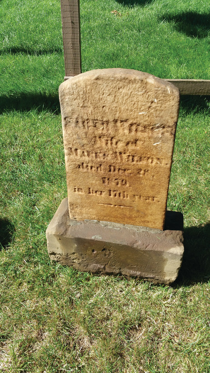 STANDING AGAIN: The headstone for Sarah Wilson, who died at the age of 16 and eight months in 1879, found buried in a private yard near Wilde's Corner is standing thanks to the efforts of the Warwick Historic Cemeteries Commission.