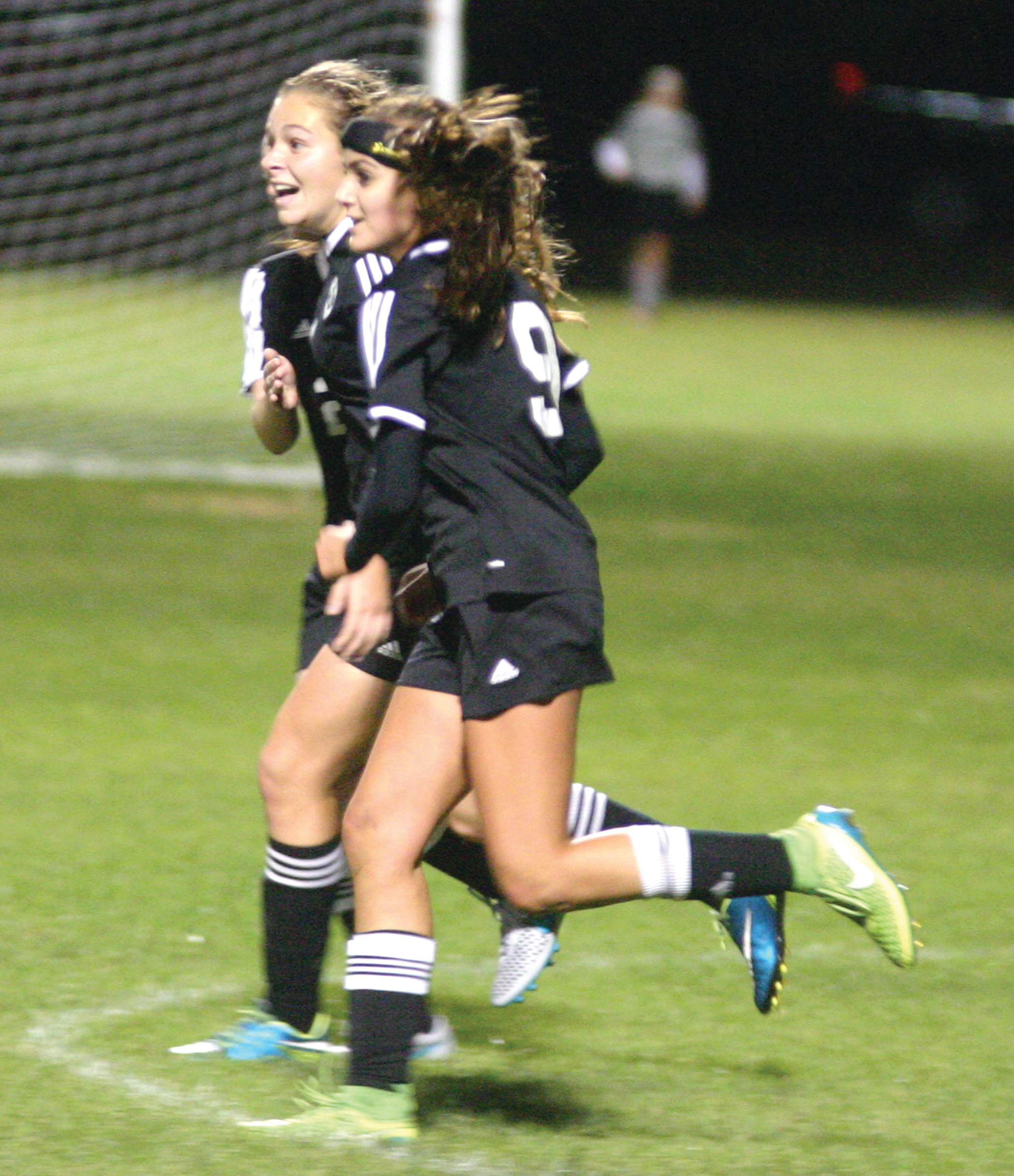 Kendra Tantimonico celebrates with teammate Jordan Petrucci (9) after scoring a goal against Toll Gate.