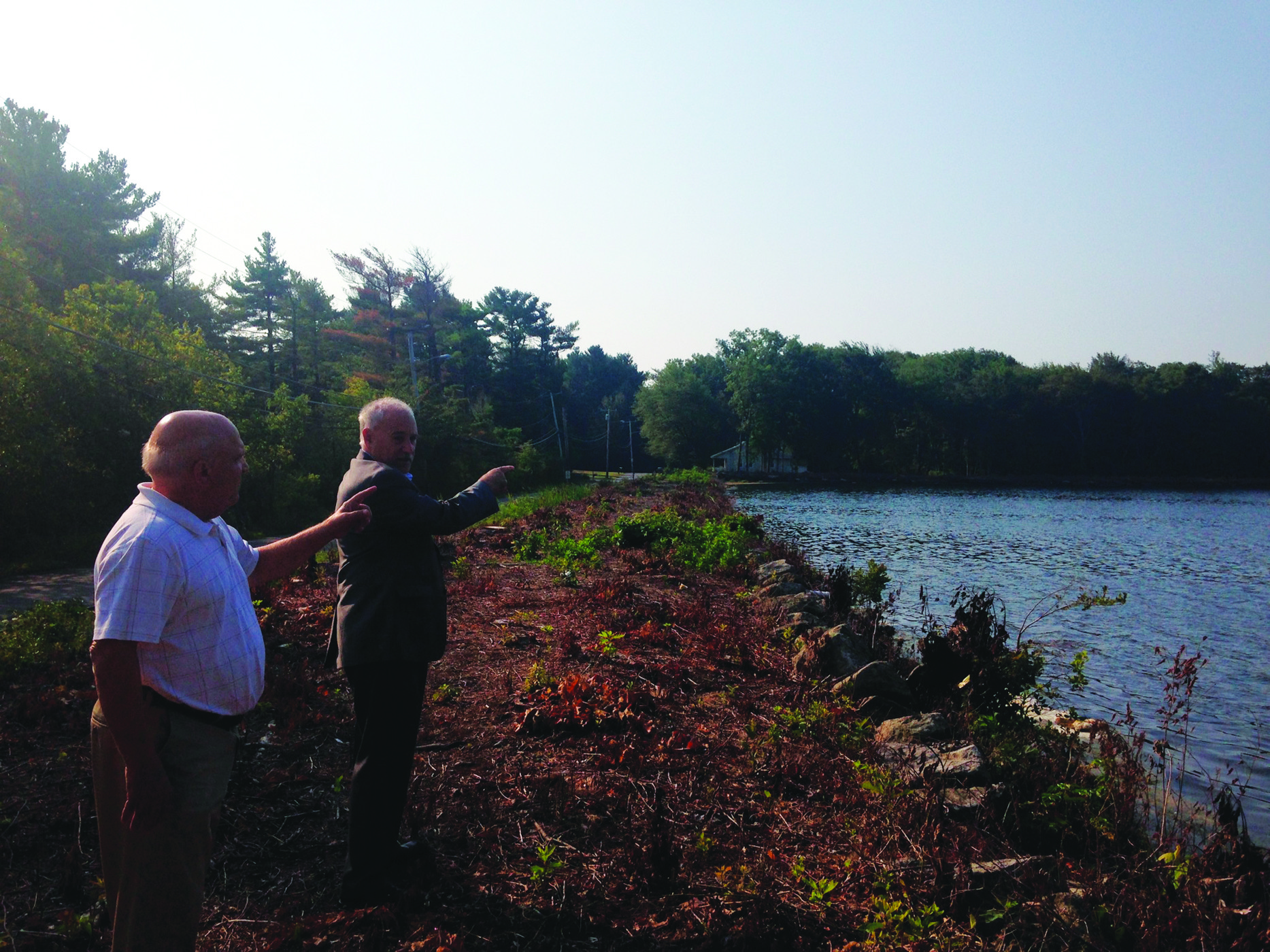 SURVEYING THE DAM: DPW Director Arnold Vecchione and Mayor Joseph Polisena tour the Oak Swamp dam as state-mandated repairs on the structure begin.