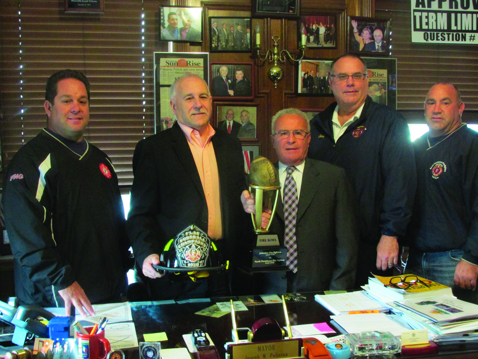 TRAVELING TROPHY: The Fire Bowl trophy is currently in the possession of the North Providence Fire Fighters Local 2334, but Johnston�s Local 1950 hopes to take it home after next Thursday night�s game. Taking part in Tuesday�s announcement were, from left, Johnston coach Dave Pingitore and Mayor Joseph Polisena, North Providence Mayor Charles Lombardi, Johnston Fire Chief Timothy McLaughlin, and North Providence coach Anthony Rampone.