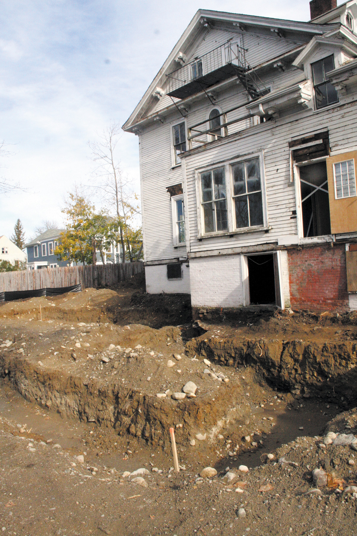 MAKING ROOM: Excavation for the foundation of a 5-unit addition on the back of the house is nearly completed. The hope is to have it done soon so work can continue through the winter.
