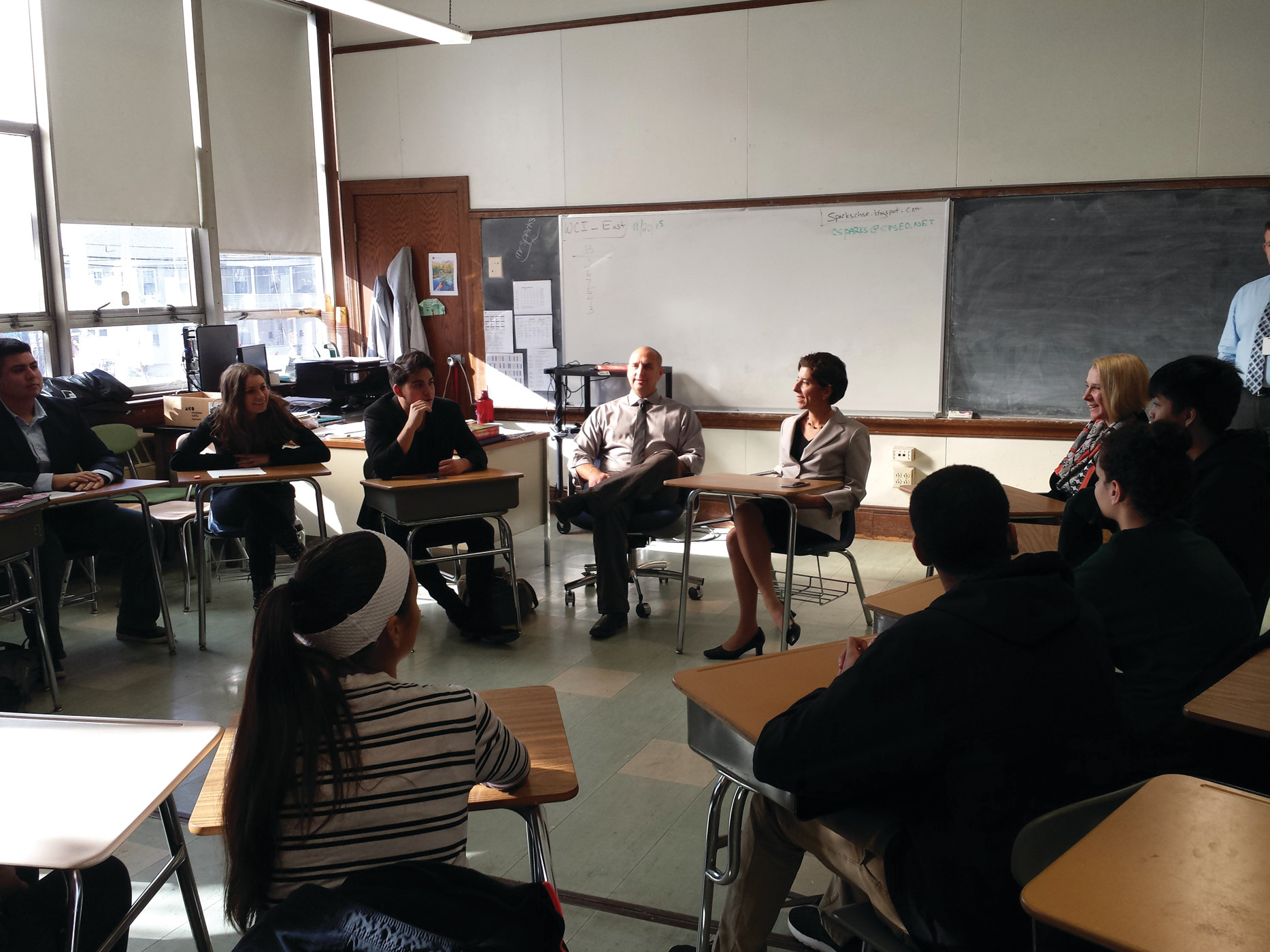 ROUNDTABLE DISCUSSIONS: Raimondo visited Cranston High School East last week, speaking with a class of students enrolled in a dual-enrollment class taught by Scott Maynard.