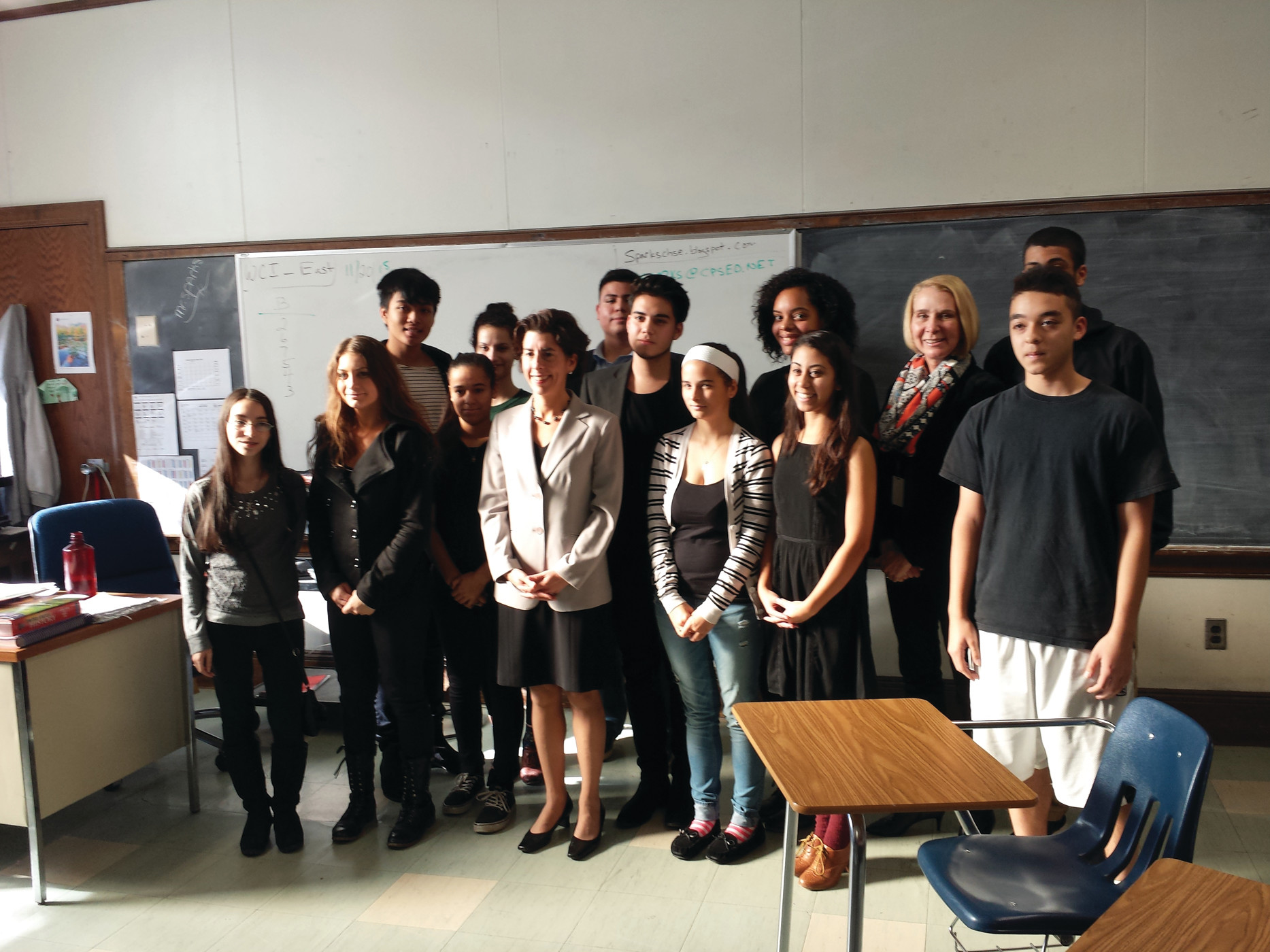 VISIT WITH THE GOVERNOR: Gov. Gina Raimondo posed with the entire class at the end of her visit.