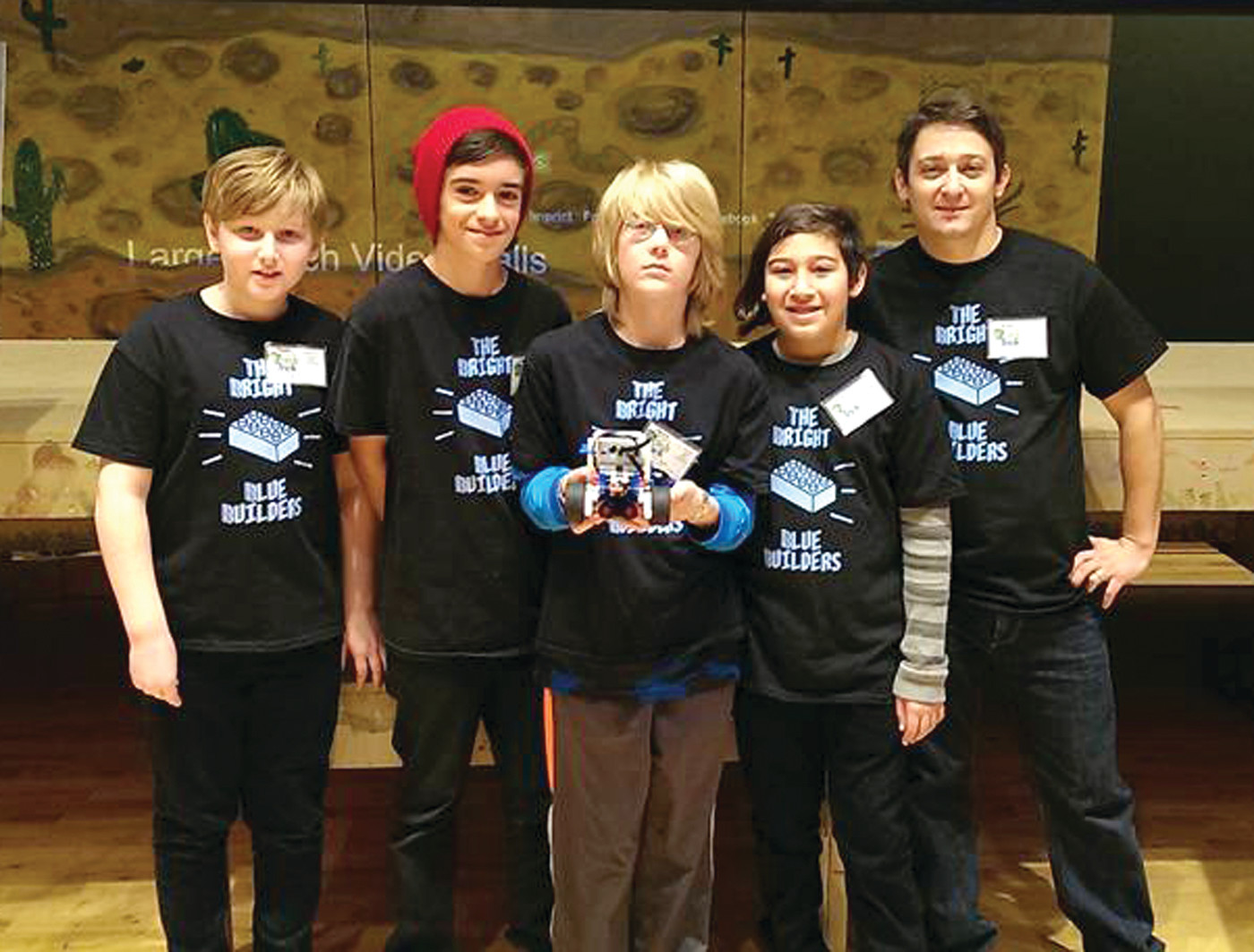 READY TO GO: The Bright Blue Builders have been spending much of their time getting ready for Saturday's competition. They are pictured here with their LEGO robot, Bob, at the qualifying event in November.