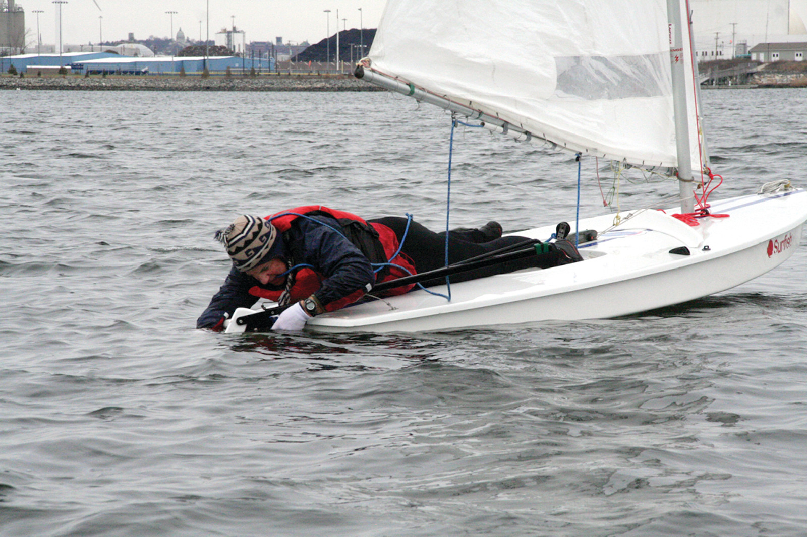 NOT WHAT YOU WANT TO HAPPEN: Jeff Lanphear finds himself practically in the water after the rudder to his boat popped free. The mid-race adjustment put him in last place for the first race. He bounced back to take a first in the second race.