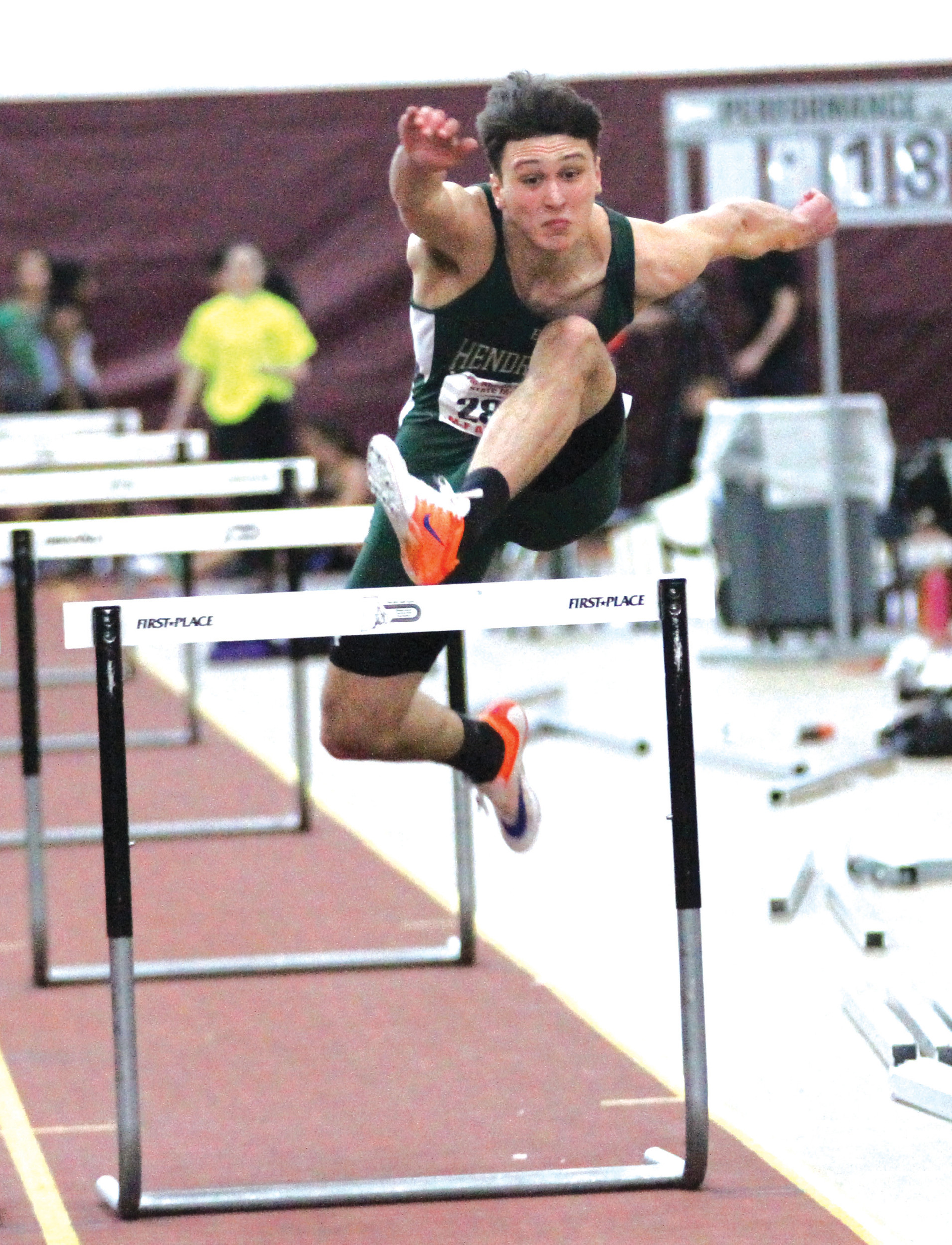 OVER THE TOP: Ethan Famiano showed his prowess in the 55-meter hurdles in New Hampshire, claiming third place.
