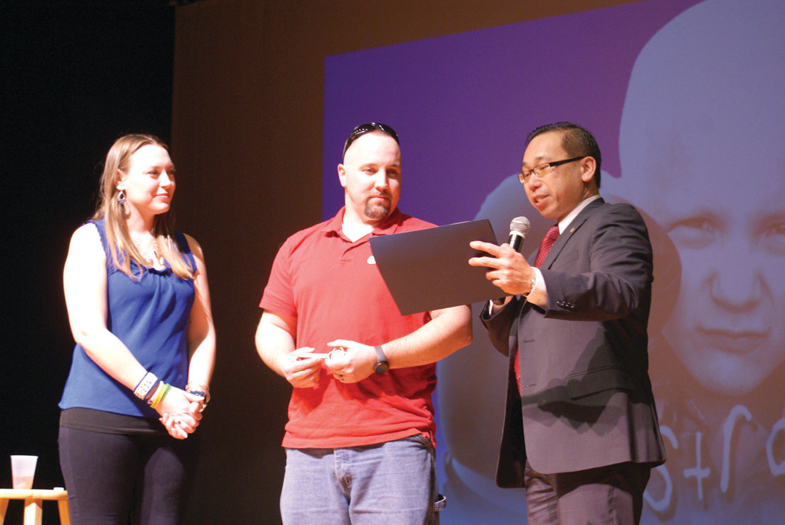 FROM THE CITY: Cranston Mayor Allan Fung presents Melissa and Christopher Murray, parents of Dorian, with a key to the city and a citation.
