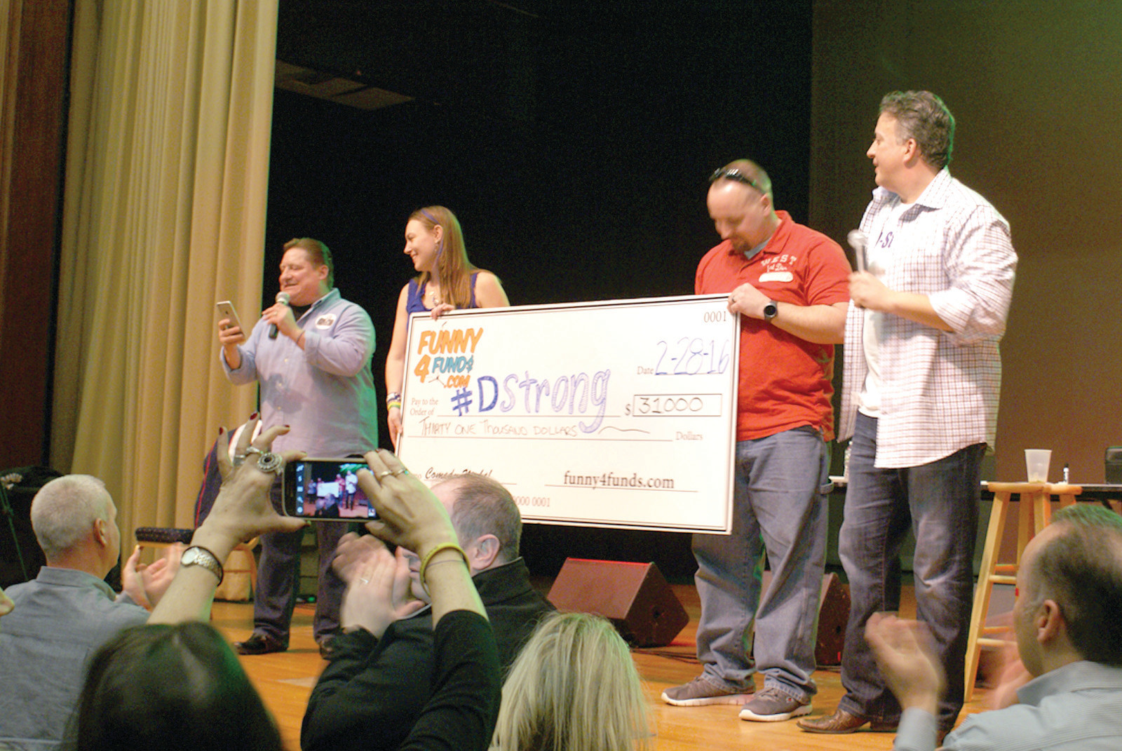 THE BIG FINISH: The big finish at the DStrong fundraiser the Park Theatre on Feb. 28 was the check presentation to Dorian Murray's parents in the amount of $31,000. Pictured are Mike Murray, Melissa Murray, Christopher Murray, and Bill Simas.