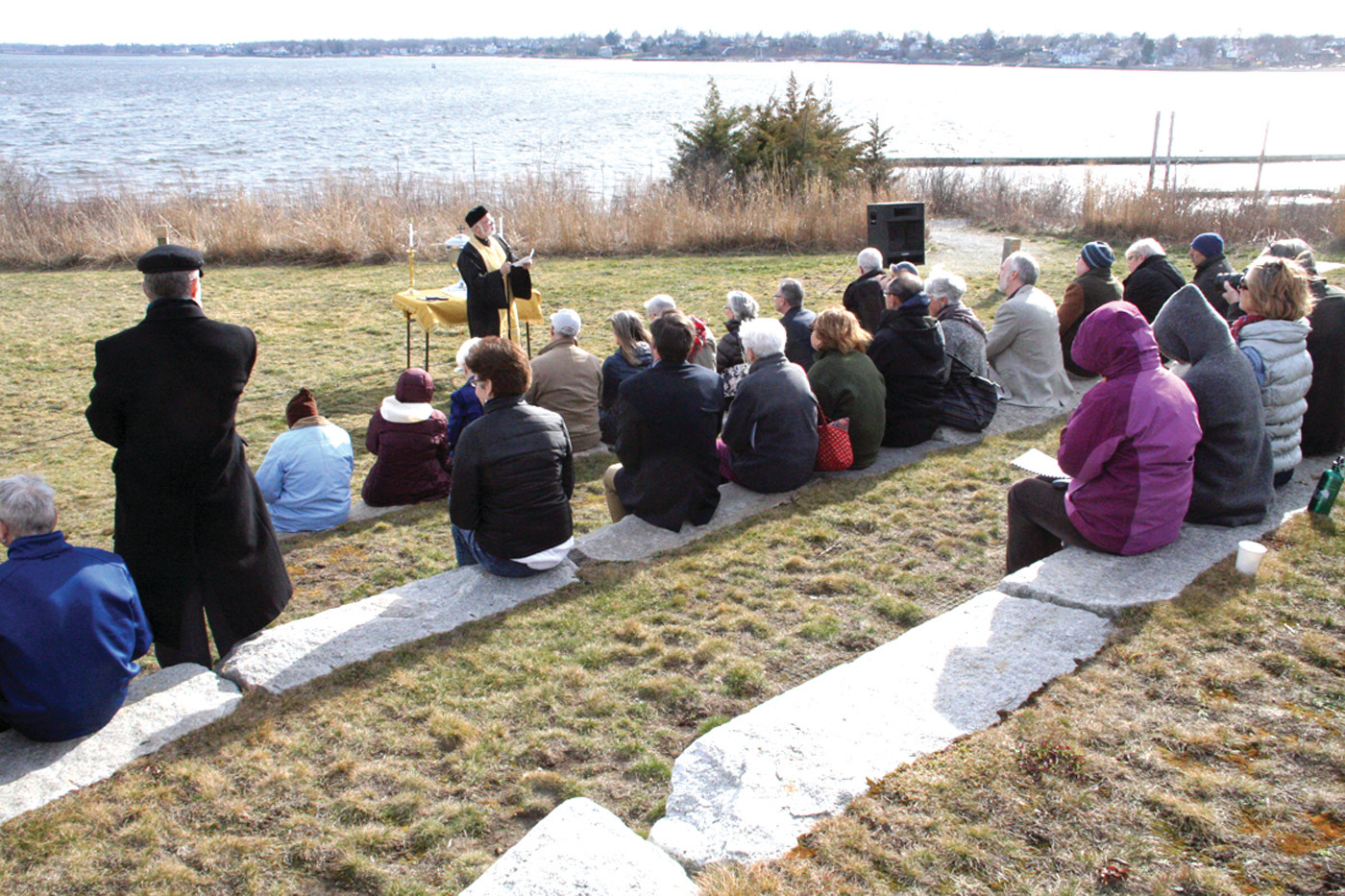 WATER, SOURCE OF LIFE: The Rev. Andrew G. George, pastor of the Church of the Annunciation Greek Orthodox Parish of Greater Providence, led a blessing of waters outside the Fields Point headquarters of Save The Bay Saturday afternoon.