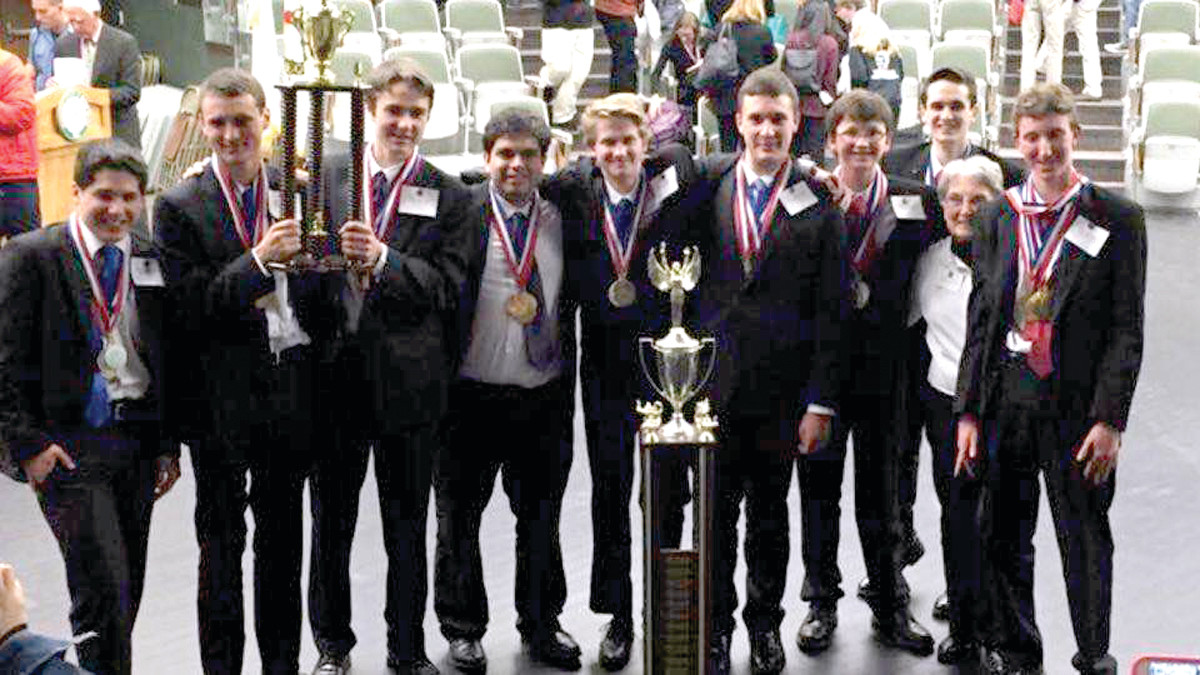 ON TO ALASKA: Hendricken is moving on to the national competition with a team made of (from left) Nathan Tomasso, Ryan Brady, Peter Cienki, Nicolas Bassi, Geoffrey Boyer, Aidan Kendra, Miles Temel, Christian Wells, Sister Carol Ann Murray and Riley Chabot.
